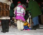 Checking DeeDee's sled bag for the mandatory items.