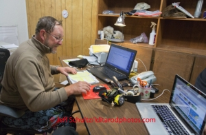 Volunteer Comm's Rob Johnson works the communication desk at McGrath on Wednesday March 5 during the 2014 Iditarod. (Photo by Jeff Schultz)