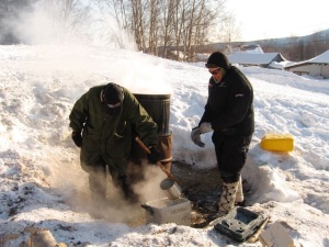 Ken Anderson getting hot water from the cooker in Takotna.