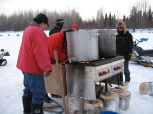 Gas stove heating water for all mushers in Skwentna.
