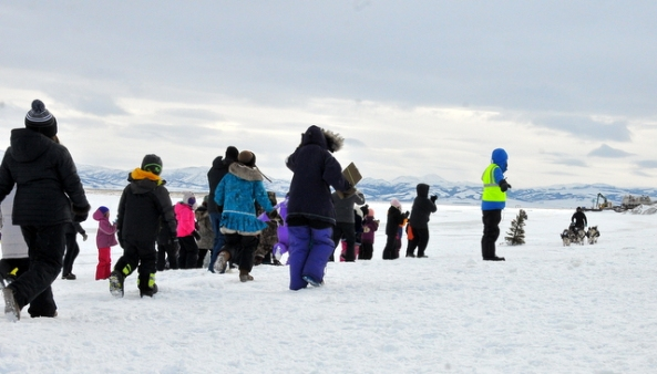 Kids watching a team come into Unalakleet
