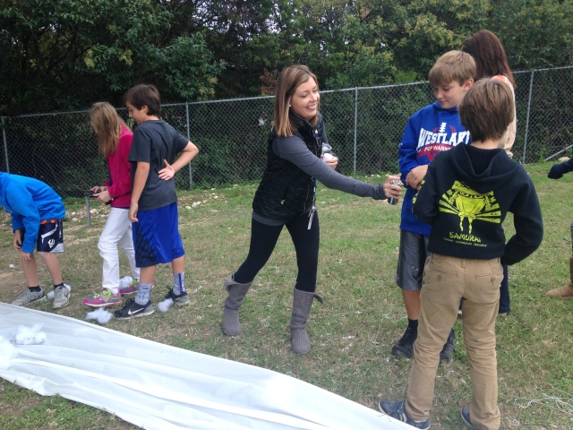 Mrs. Bromlow in action with silly string